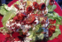 Wedge Salad with Roasted Tomatoes, Bacon, Chia Seeds, Sauteed Onions, and Ranch Dressing