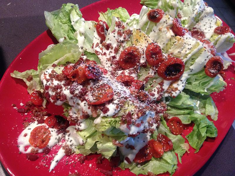 Wedge Salad with Roasted Tomatoes, bacon, and Chia Seeds.